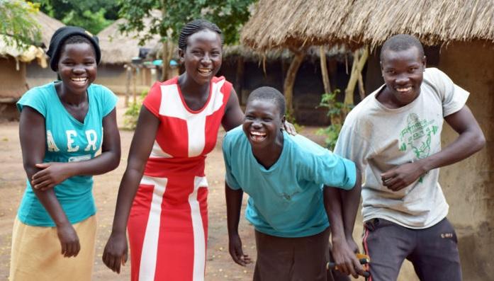 Ugandan youth smiling and laughing