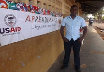 Gilberto Daniel in front of school in Mozambique