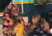 Isatu Bangura speaks to a lieracy class in Freetown