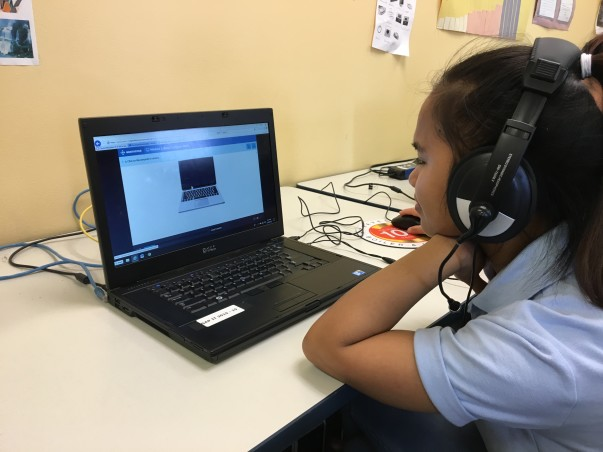A girl takes the Northstar Digital Literacy Assessment on a computer