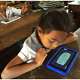 Girl using tablet with Cambodia TEST project