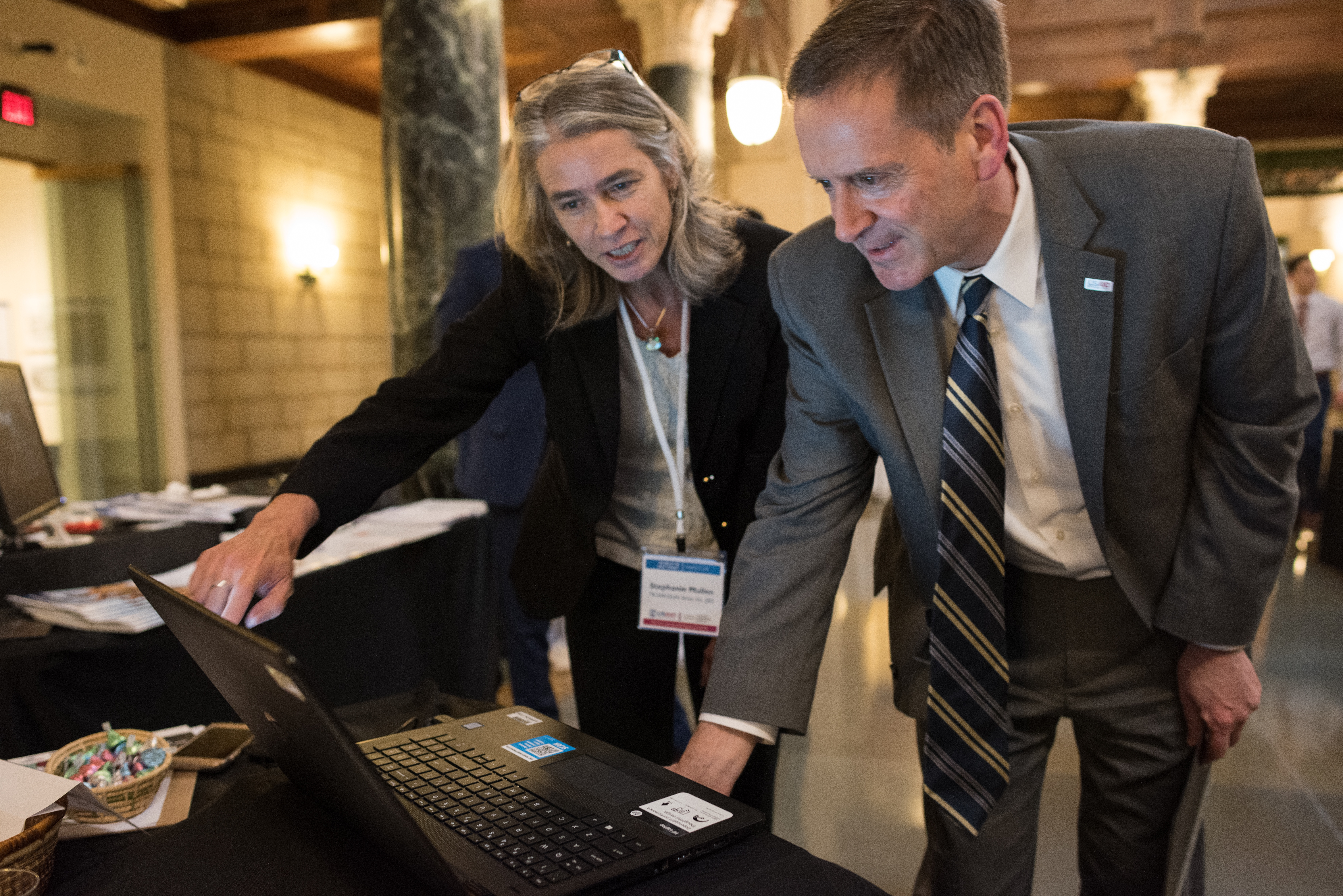 JSI's Stephanie Mullen, Project Director for TB DIAH, shows USAID Administrator, Mark Green, the data hub dashboard