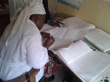 Hajiya Binta Madawaki conducting RI settlement data analysis. Photo credit: JSI/MCSP Muhammed Abdulkarim.
