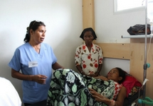 During her clinical practice in Dili, Carmen calmly explains the delivery process to a young woman.