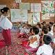 Children and teacher reading Thailand Myanmanr small news item photo
