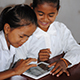 Cambodian girls reading on a tablet