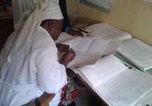 Haj Binta Madawaki conducting RI settlement data analysis.